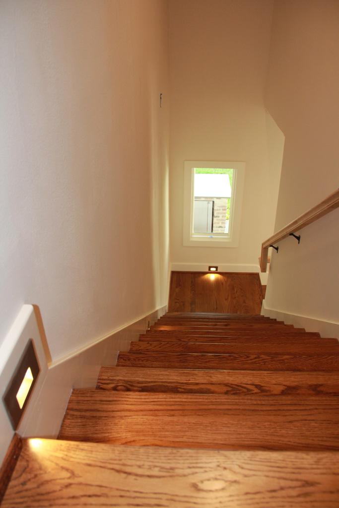 Stairway with custom wood floors and lighting