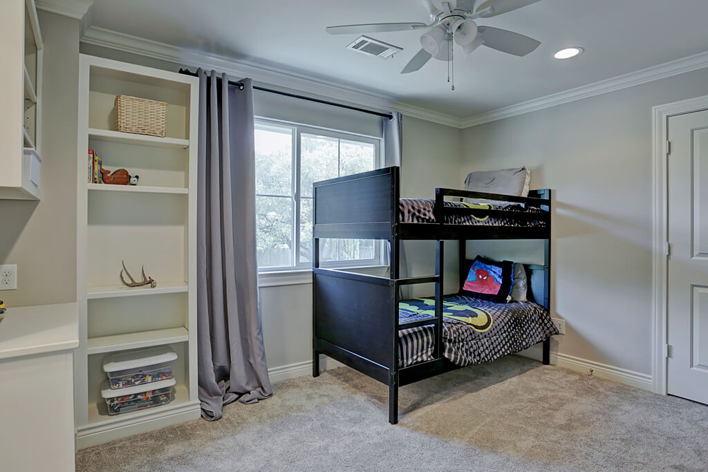 Remodeled bedroom with custom built in shelving